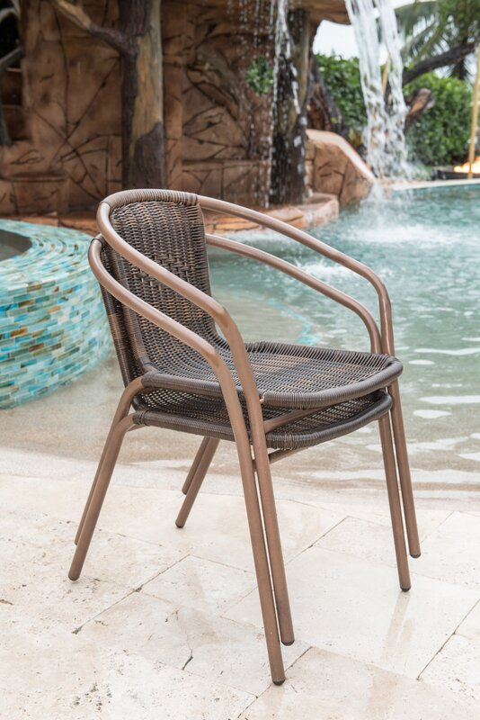 stackable outdoor chairs by the pool