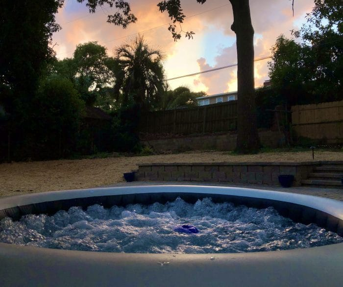 Inflatable hot tub with sunset in background